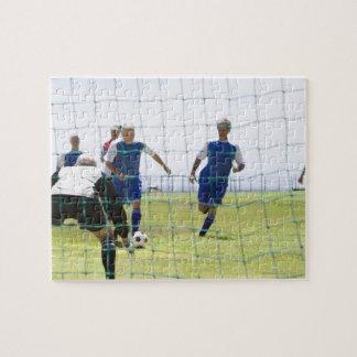 mature men kicking soccer ball towards puzzles
