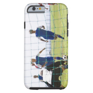 mature men kicking soccer ball towards tough iPhone 6 case