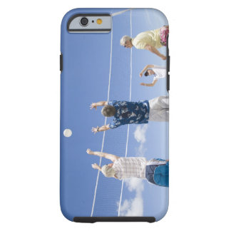Mature men leaping for volley ball on beach, tough iPhone 6 case