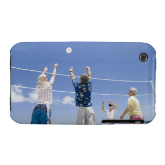 Mature men leaping for volley ball on beach, iPhone 3 covers