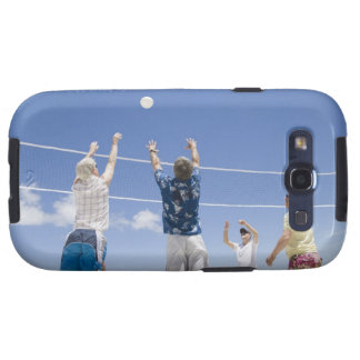 Mature men leaping for volley ball on beach, galaxy SIII covers