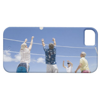 Mature men leaping for volley ball on beach, iPhone 5 case
