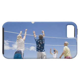 Mature men leaping for volley ball on beach, iPhone 5 cases