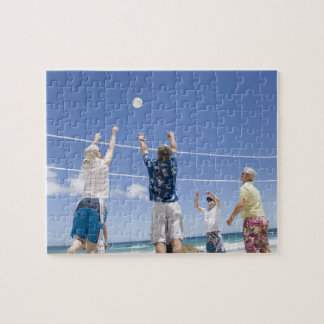 Mature men leaping for volley ball on beach, jigsaw puzzle