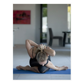 Mature woman exercising 3 postcard
