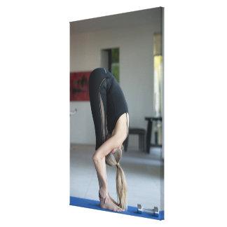 Mature woman exercising canvas print