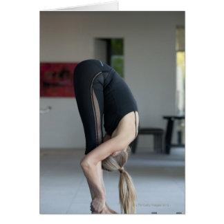 Mature woman exercising greeting card