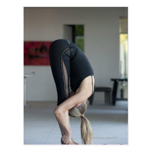 Mature woman exercising postcard
