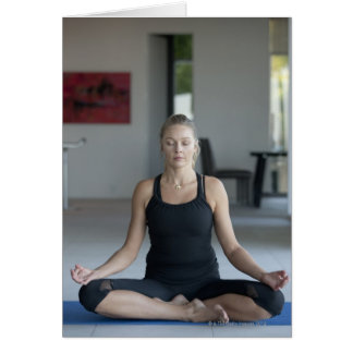 Mature woman practicing yoga greeting card