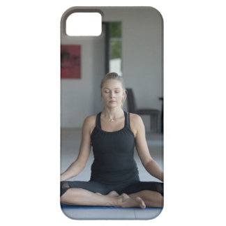 Mature woman practicing yoga iPhone 5 case