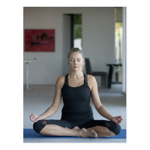 Mature woman practicing yoga postcards