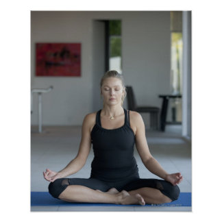 Mature woman practicing yoga poster