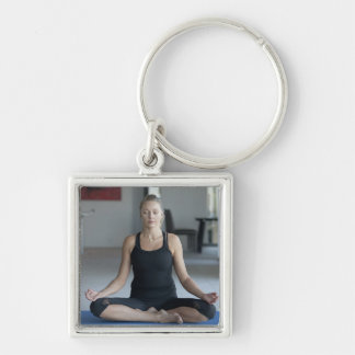 Mature woman practicing yoga Silver-Colored square key ring