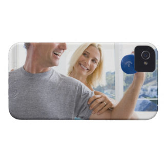 Mature woman smiling at mature man lifting iPhone 4 Case-Mate cases