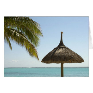 Mauritius. Idyllic beach scene with umbrella Card