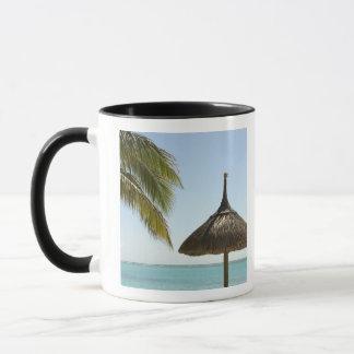 Mauritius. Idyllic beach scene with umbrella Mug