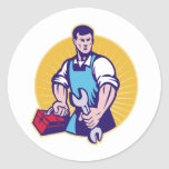 Mechanic tradesman worker holding spanner toolbox round stickers