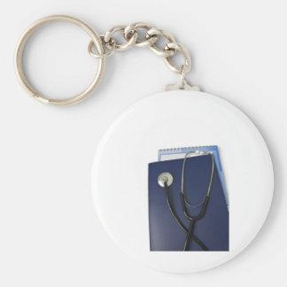 medical stethoscope on blue folder basic round button key ring