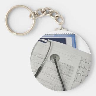 medical stethoscope on cardiogram EKG readings Basic Round Button Key Ring