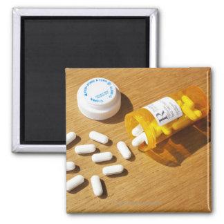Medication spilled on table fridge magnets