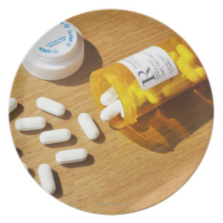 Medication spilled on table party plates