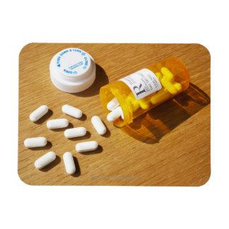 Medication spilled on table rectangular photo magnet