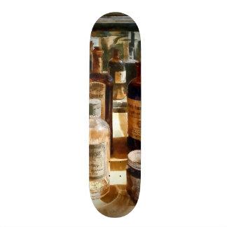 Medicine Bottles in Glass Case Skate Decks