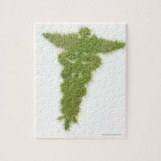 Medicine symbol made of grass puzzles