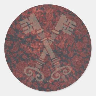 Medieval 21st keys against dark red marble round sticker