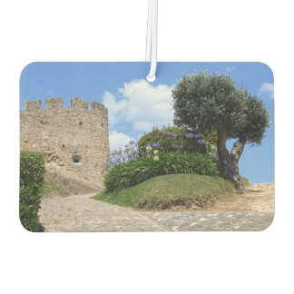 Medieval castle and an olive tree