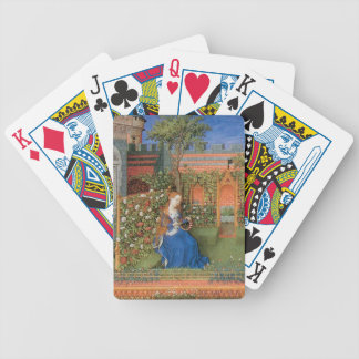 Medieval lady in rose garden bicycle playing cards