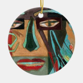 Medusa. portrait of a shaman round ceramic decoration