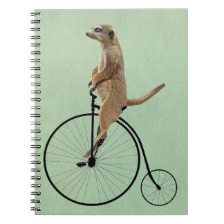 Meerkat on Black Penny Farthing 2 Spiral Notebook