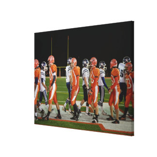 Meeting of teams of American football in field, Canvas Print