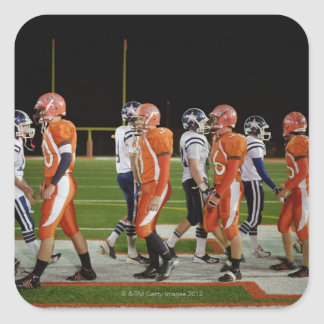 Meeting of teams of American football in field, Square Sticker