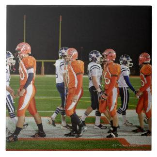 Meeting of teams of American football in field, Tile