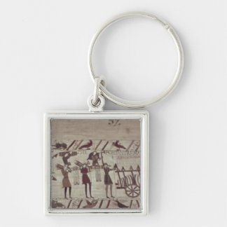 Men carrying arms to the ships and pulling a key ring