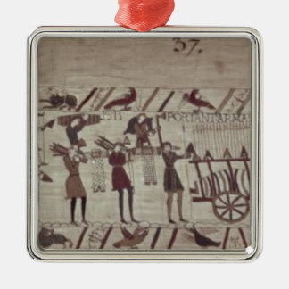 Men carrying arms to the ships and pulling a Silver-Colored square decoration