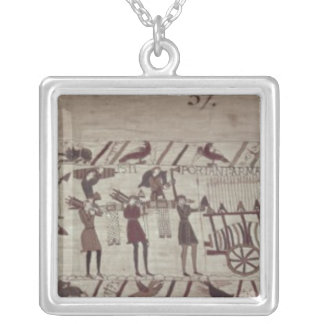 Men carrying arms to the ships and pulling a silver plated necklace