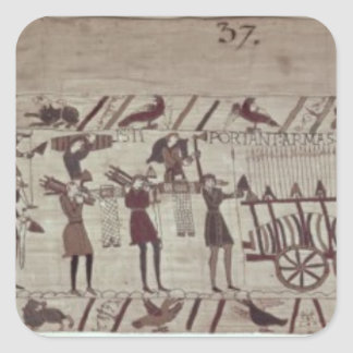 Men carrying arms to the ships and pulling a square sticker