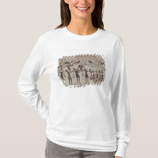 Men carrying arms to the ships and pulling a T-Shirt
