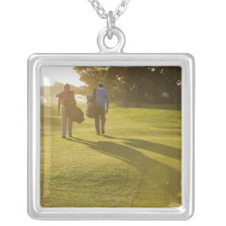 Men carrying golf bags on golf course silver plated necklace