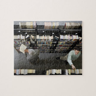 Men in library looking for books jigsaw puzzle