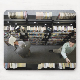 Men in library looking for books mouse pad