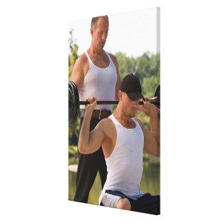 Men lifting barbell canvas print