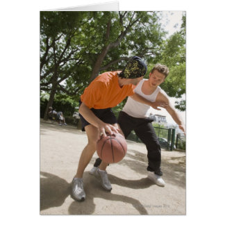 Men playing basketball outdoors card