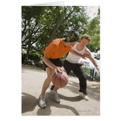 Men playing basketball outdoors cards