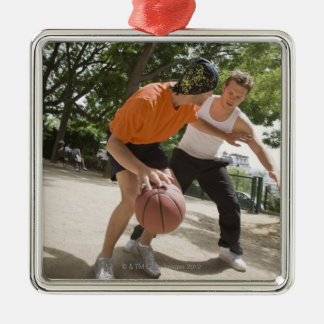 Men playing basketball outdoors ornaments