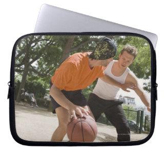 Men playing basketball outdoors laptop sleeve