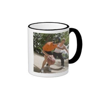 Men playing basketball outdoors coffee mug